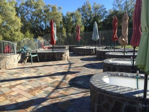 The outdoor hot tubs on the patio by the swimming pool.