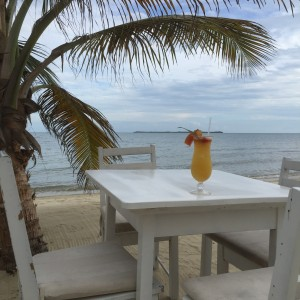 Mai tai's at the open air Ocean Club Bar and Grill, steps from the Caribbean ocean.
