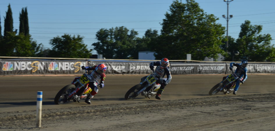 Three motorcycles race to the finish at Sacramento Mile.